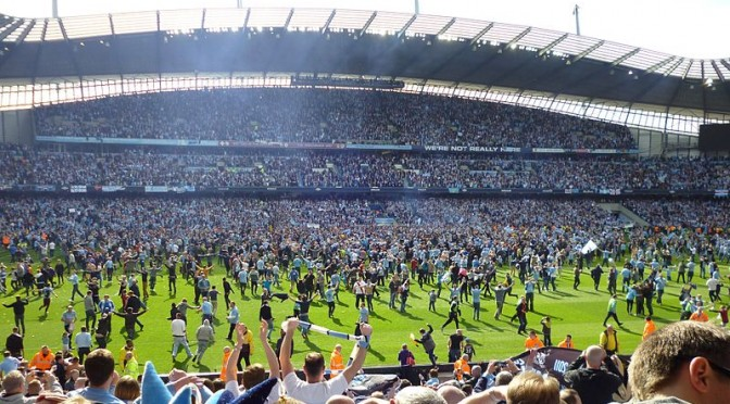 An image of Manchester City fans celebrating winning the league in 2012. The club have been particularly affected by Financial Fair Play.